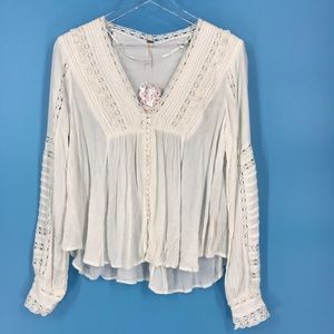 Free People white button down V-neck blouse.